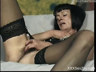 Mature lady in stockings gets ass-blasted by a hung dog