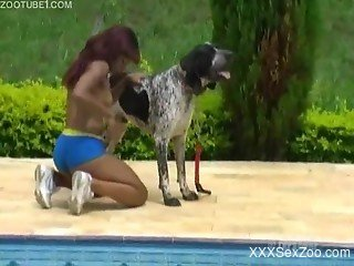 Tanned and exotic babe fucked by a big-dicked dog