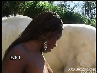 Ebony slut sucks a stallion cock at the farm