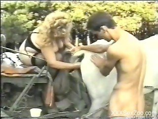 Amazing outdoor anal sex with a white stallion