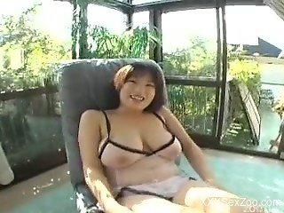 Short-haired Asian slut nicely sucks a tasty dog sausage